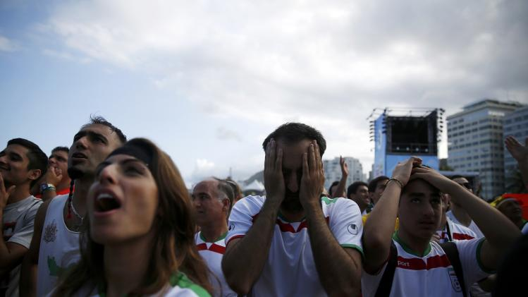 Iranian soccer fans react as they watch the 2014 World Cup soccer match between Argentina and Iran on a large screen at Copacabana beach in Rio de Janeiro