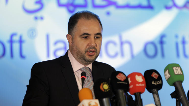 Rajai S. El-Khadem, Microsoft Manager of Business Development for Emerging Markets speaks to the media in Baghdad, Iraq, Monday, May 28, 2012. Microsoft Corp. says it has appointed a local company to distribute its products in Iraq in what it says is a sign of growth for the war-plagued country. (AP Photo/Khalid Mohammed)