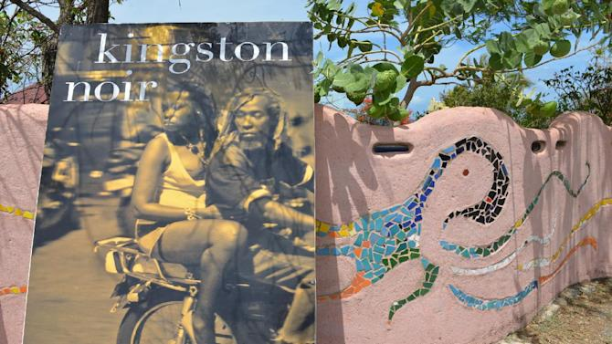 The cover of a large facsimile of a Jamaican book is shown propped against a decorative wall in Treasure Beach, Jamaica, Sunday, June 1, 2014. Since 2001, the tiny, laid-back beach town in arid southern Jamaica has hosted the Calabash International Literary Festival, attracting Nobel laureates and a slew of other acclaimed writers. From modest beginnings, Calabash has transformed itself as a major international literary event. (AP Photo/David McFadden)