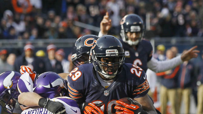 Chicago Bears running back Michael Bush (29) rushes for a touchdown against Minnesota Vikings safety Jamarca Sanford (33) in the first half of an NFL football game in Chicago, Sunday, Nov. 25, 2012. (AP Photo/Charles Rex Arbogast)