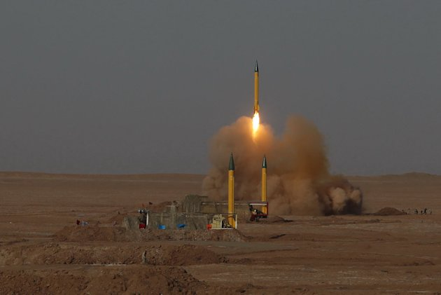FILE - In this Tuesday, July 3, 2012 file photo released by the Iranian Fars News Agency, a surface-to-surface missile is launched during the Iranian Revolutionary Guards maneuver in an undisclosed location in Iran. War games carried out in July 2012 showed missiles with improved accuracy and firing capabilities, Iranian media reports said Friday, July 13, 2012, an apparent response to stepped up Western sanctions over Iran's nuclear program. (AP Photo/Fars News Agency, Hamed Jafarnejad, File) THE ASSOCIATED PRESS HAS NO WAY OF INDEPENDENTLY VERIFYING THE CONTENT, LOCATION OR DATE OF THIS IMAGE.