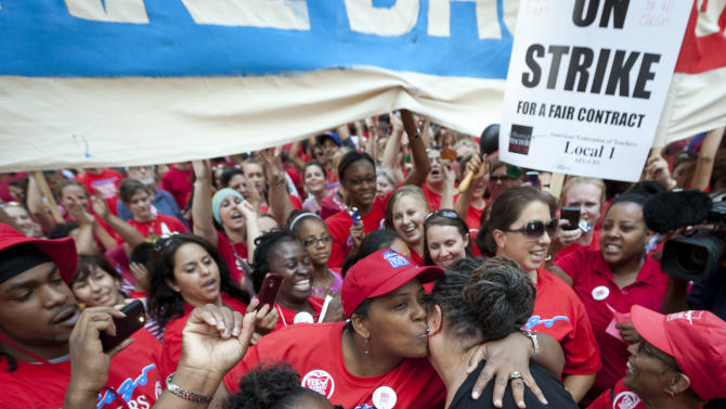 Chicago Teachers Union President Karen Lewis is embraced by a teacher during an unexpected appearance at a rally of thousands of public school teachers outside the Chicago Board of Education district headquarters on Tuesday, Sept. 11, 2012 in Chicago. Teachers walked off the job Monday for the first time in 25 years over issues that include pay raises, classroom conditions, job security and teacher evaluations. (AP Photo/Sitthixay Ditthavong)