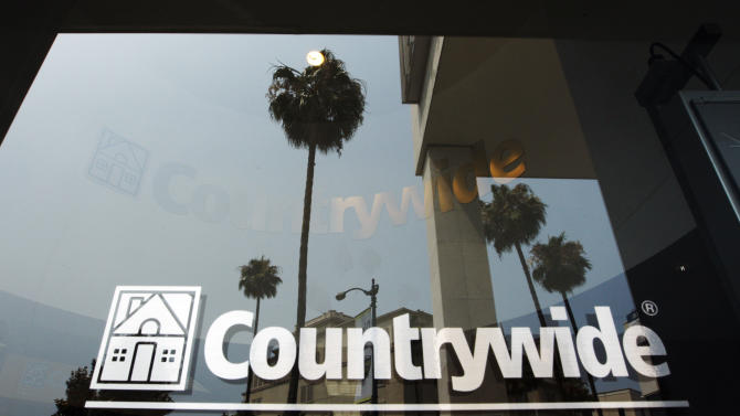 FILE - In this June 25, 2008 file photo, buildings and palm trees are reflected on the entrance of the Countrywide Financial Corp. office in Beverly Hills, Calif.  The top federal prosecutor in Manhattan sued Bank of America for more than $1 billion on Wednesday, Oct. 24, 2012 for mortgage fraud against Fannie Mae and Freddie Mac during the years around the financial crisis.  (AP Photo/Kevork Djansezian, file)