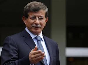 Turkey's Foreign Minister Davutoglu addresses the media in Ankara