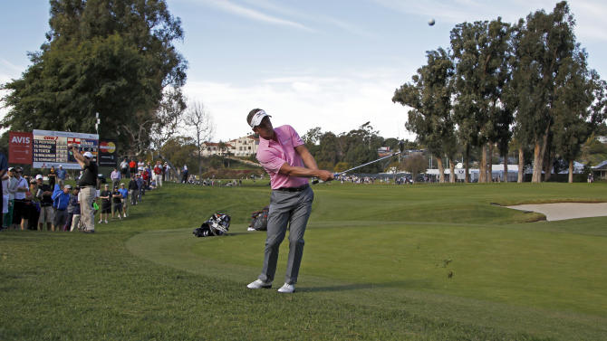 Luke Donald, of England, chips to the first green on his way to birdie in the third round of the Northern Trust Open golf tournament at Riviera Country Club in the Pacific Palisades area of Los Angeles Saturday, Feb. 16, 2013. (AP Photo/Reed Saxon)