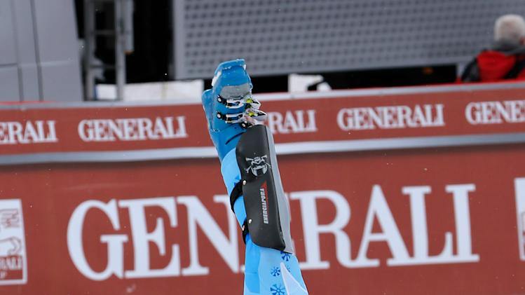 Slovenia's Tina Maze performs a cartwheel as she celebrates after winning an alpine ski, women's world cup super-combined, in Meribel, France, Sunday, Feb. 24, 2013. (AP Photo//Marco Trovati)