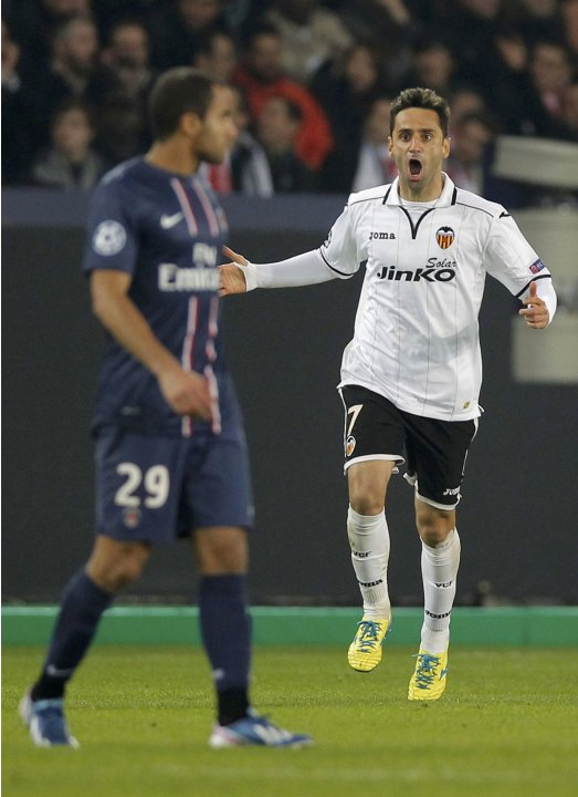 Valencia's Jonas celebrates after scoring the first goal for the team during their Champions League soccer match against Paris St Germain at the Parc des Princes stadium in Paris