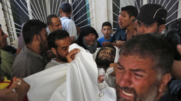 Palestinian who lost family members react at a hospital in the northern Gaza Strip