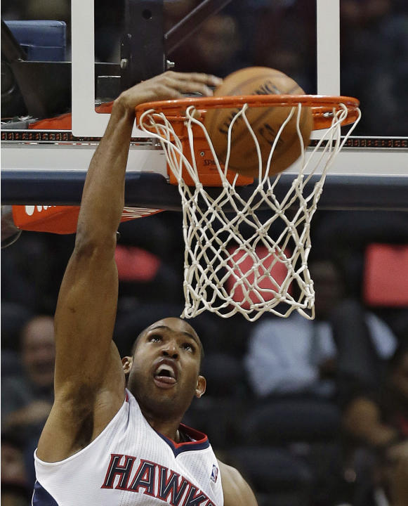 Atlanta Hawks center Al Horford (15) scores in the second half of an NBA  basketball game against the Los Angeles Clippers Wednesday, Dec. 4, 2013, in Atlanta.  Atlanta won 107-97