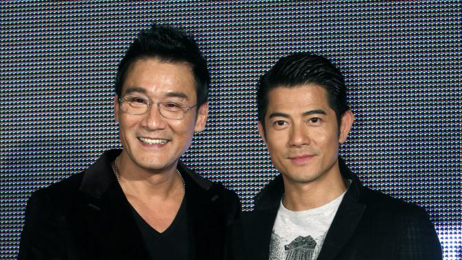 "In this photo taken on Monday, Nov. 12, 2012, Hong Kong actors Aaron Kwok, right, and Tony Leung Ka Fai pose for the media during a promotional event for their new film ""Cold War"" in Taipei, Taiwan. (AP Photo/Chiang Ying-ying)"