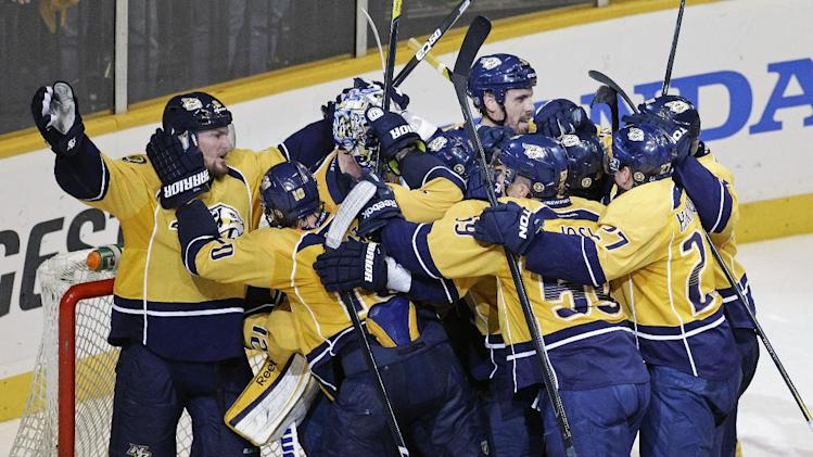 The Nashville Predators celebrate after defeating the Detroit Red Wings 2-1 in Game 5 of a first-round NHL hockey playoff series on Friday, April 20, 2012, in Nashville, Tenn. The Predators won the series 4-1. (AP Photo/Mark Humphrey)