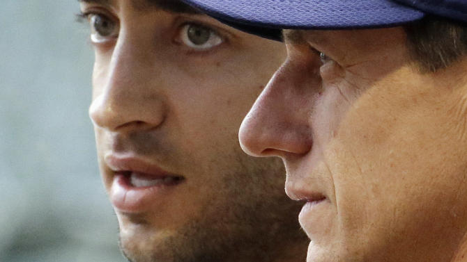 Milwaukee Brewers new manager Craig Counsell, right, talks to Ryan Braun during batting practice before a baseball game against the Los Angeles Dodgers Monday, May 4, 2015, in Milwaukee. (AP Photo/Morry Gash)