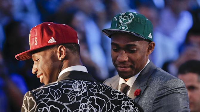 Andrew Wiggins, left, and Jabari Parker stop for television interviews after being selected as the top two picks in the 2014 NBA draft, Thursday, June 26, 2014, in New York. Wiggins was selected number one by the Cleveland Cavaliers and Parker was chosen number two by the Milwaukee Bucks