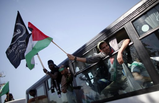 Palestinians who were freed from Israeli jails as part of a prisoners exchange deal arrive at the Rafah border crossing in the Gaza Strip