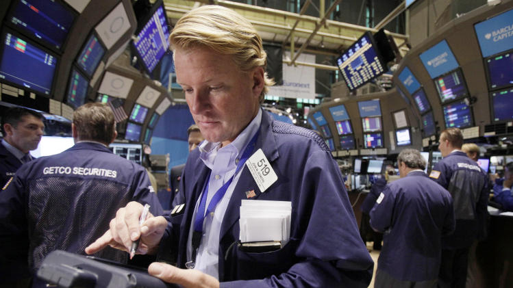 In this Aug. 1, 2011, trader John Bowers works on the floor of the New York Stock Exchange. Global stock markets tumbled Tuesday, Aug. 2, after downbeat U.S. data fueled fears the world's largest economy might be sliding back into recession.(AP Photo/Richard Drew)