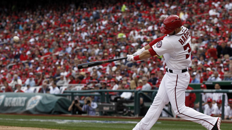 Washington Nationals left fielder Bryce Harper (34) hits a solo home run in the first inning of the opening day baseball game against the Miami Marlins in Washington, on Monday, April 1, 2013.  (AP Photo/Alex Brandon)