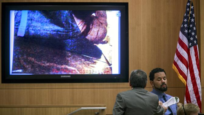 Prosecutor Juan Martinez hands a phone log to Verizon analyst Jody Citizen during the trial of Jodi Arias at the Maricopa County Superior Court on Tuesday, Jan. 15, 2013, in Phoenix. Citizen, a senior analyst/legal with Verizon, explained phone call logs between Travis Alexander and Arias. Arias is charged with murder in the death of her boyfriend, Travis Alexander, and prosecution is seeking the death penalty.(AP Photo/The Arizona Republic, Charlie Leight)