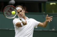 Roger Federer of Switzerland returns a shot to Fabio Fognini of Italy during a second round men's singles match at the All England Lawn Tennis Championships at Wimbledon, England, Wednesday, June 27, 2012. (AP Photo/Kirsty Wigglesworth)