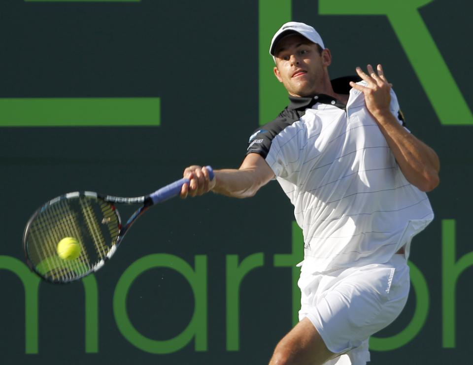 Andy Roddick, of the United States, returns to Juan Monaco, of Argentina, during the Sony Ericsson Open tennis tournament in Key Biscayne, Fla., Tuesday, March 27, 2012. (AP Photo/Alan Diaz)