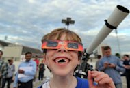 "Eight-year-old Alex Olling watches Venus crossing the sun's face in the US state of Maryland on June 5. ""Everyone's having a great time,"" NASA scientist Richard Vondrak said from the Goddard Space Flight Center in Maryland, where 600 people gathered to observe the fiery planet of love"