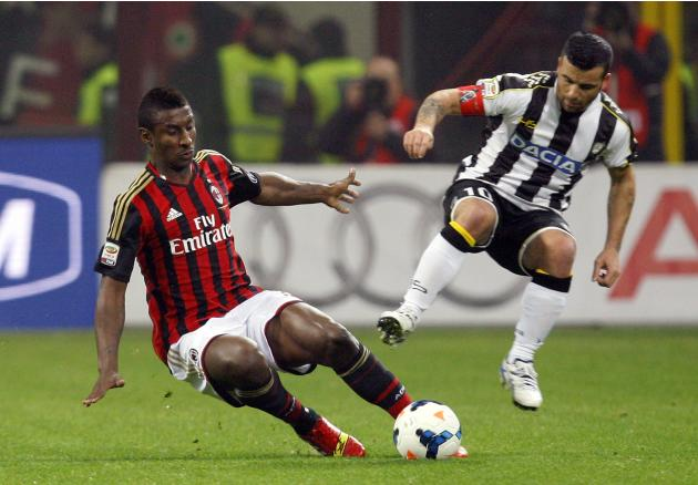 AC Milan's Constant fights for the ball with Udinese's Di Natale during their Italian Serie A soccer match in Milan