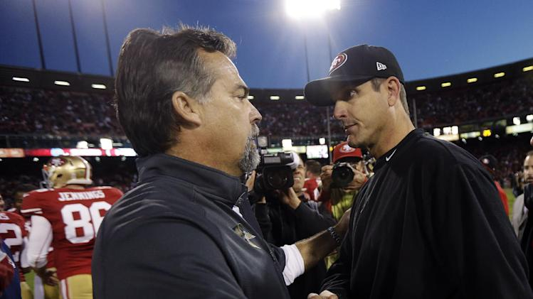 St. Louis Rams head coach Jeff Fisher, left, shakes hands with San Francisco 49ers head coach Jim Harbaugh at the end of their NFL football game in San Francisco, Sunday, Nov. 11, 2012. San Francisco and St. Louis tied their game 24-24. (AP Photo/Marcio Jose Sanchez)