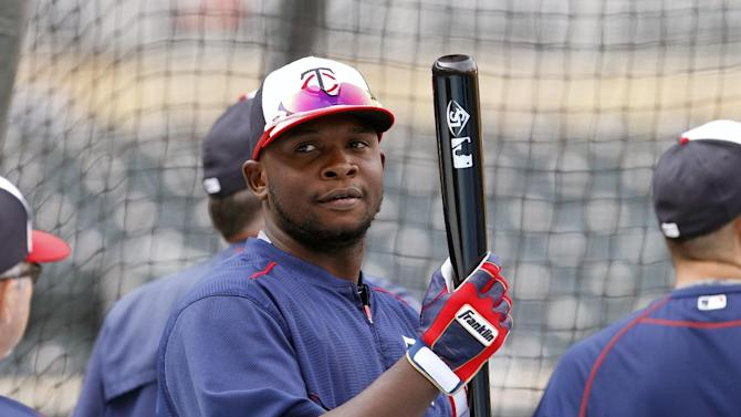 Minnesota Twins' Miguel Sano waits to bat before a baseball game against the Houston Astros in Minneapolis, Friday, Aug. 28, 2015. Sano was scratched from the lineup because of a hamstring injury. (AP Photo/Ann Heisenfelt)
