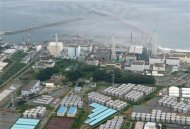 An aerial view shows Tokyo Electric Power Co. (TEPCO)'s tsunami-crippled Fukushima Daiichi nuclear power plant and its contaminated water storage tanks (bottom) in Fukushima, in this August 20, 2013 file photo taken by Kyodo. REUTERS/Kyodo/Files