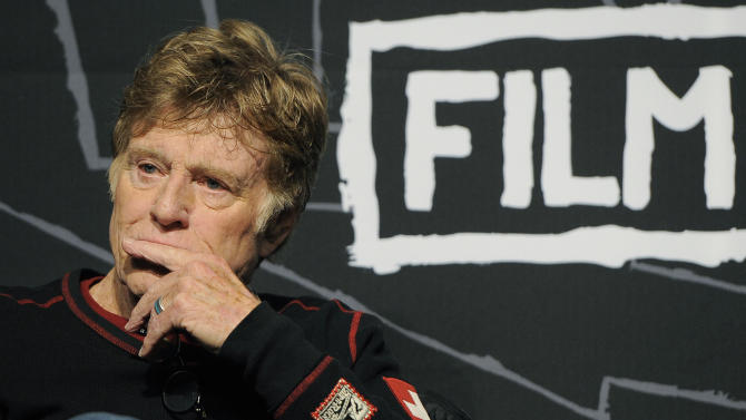 Robert Redford, founder and president of the Sundance Institute, listens to a questioner during the opening news conference of the 2013 Sundance Film Festival, Thursday, Jan. 17, 2013, in Park City, Utah. (Photo by Chris Pizzello/Invision/AP)