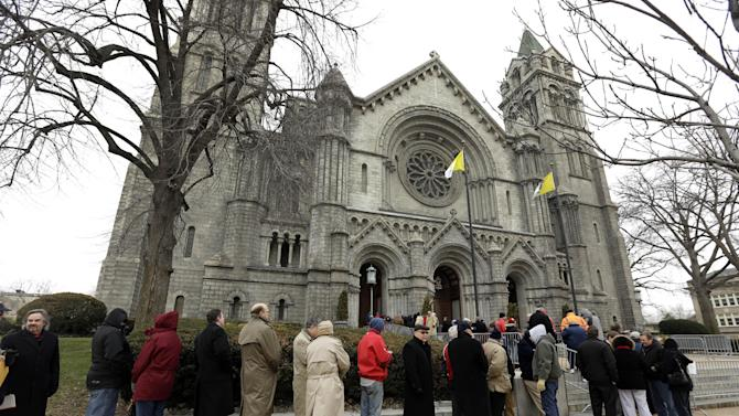 Mourners line up outside Cathedral Basilica of Saint Louis to pay their respects during the public visitation for former St. Louis Cardinals baseball player Stan Musial Thursday, Jan. 24, 2013, in St. Louis. Musial, one of baseball's greatest hitters and a Hall of Famer with the Cardinals for more than two decades, died Saturday, Jan. 19, 2013. He was 92. (AP Photo/Jeff Roberson)