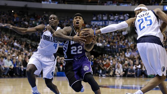 Dallas Mavericks' Darren Collison (4) pressures Sacramento Kings' Isaiah Thomas (22) as Mavericks' Vince Carter (25) attempts to strip the ball in the first half of an NBA basketball game Wednesday, Feb. 13, 2013, in Dallas. Carter was charged with a foul on the play. (AP Photo/Tony Gutierrez)