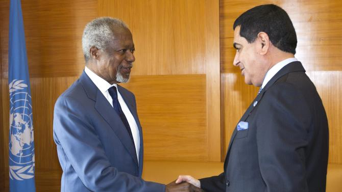 The Joint Special Envoy for Syria Kofi Annan, left, and President of the United Nations General Assembly Nassir Abdulaziz Al-Nasser, right, shake hands before their official talks at the European headquarters of the United Nations, in Geneva, Switzerland, Tuesday, May 8, 2012. (AP Photo/Keystone, Salvatore Di Nolfi)