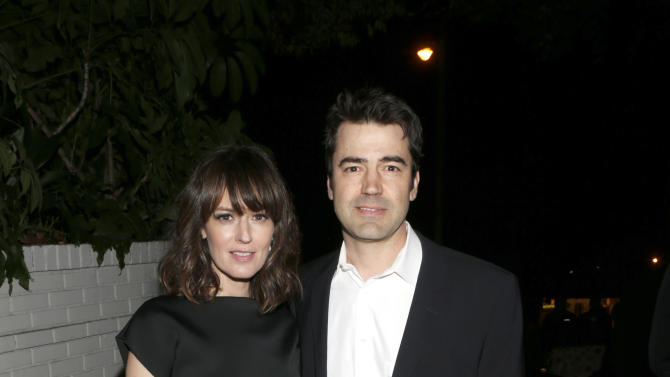 Rosemarie DeWitt and Ron Livingston attend the W Magazine's Best Performances and Golden Globe Awards Party Presented by Cadillac, on Friday, January, 11, 2013 in Los Angeles. (Photo by Todd Williamson/Invision for Cadillac/AP Images)