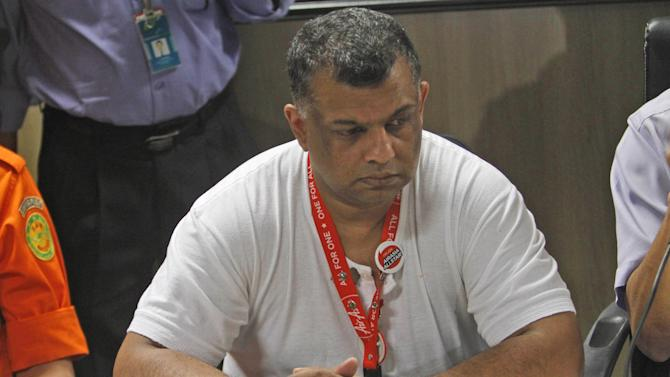 AirAsia Group CEO Tony Fernandes ponders during a press conference at Juanda International Airport in Surabaya, East Java, Indonesia, Sunday, Dec. 28, 2014. A massive sea search was underway for an AirAsia plane that disappeared Sunday while flying from Indonesia to Singapore through airspace possibly thick with dense storm clouds, strong winds and lightning, officials said. (AP Photo/Trisnadi)