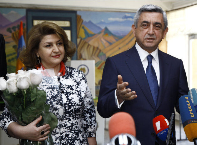 Armenian President and Republican Party President Serge Sarkisian speaks to press after he voted during parliamentary elections in Yerevan, Armenia on Sunday, May 6, 2012 President's wife Rita Sarkisi