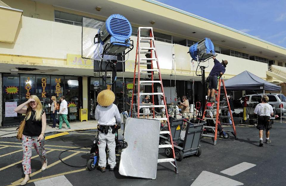 "In this July 24, 2013, photo, film crews prepare the set for rehearsal and taping of an episode of ""Burn Notice"" in Miami. The cable spy drama is coming to an end after seven seasons with a big finale Thursday, Sept. 12, 2013. (AP Photo/Alan Diaz)"
