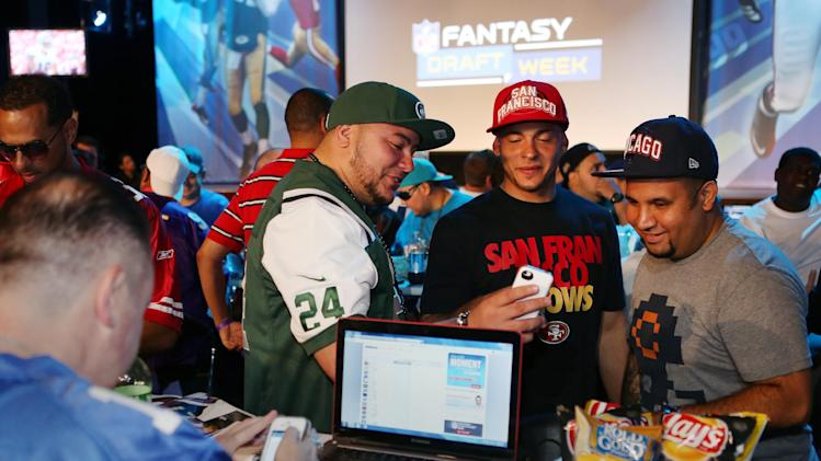 COMMERCIAL IMAGE-Fans enjoy the DirecTV NFL Fantasy Week on Friday, Aug. 24, 2012 at the Best Buy theatre in Times Square in New York. (John Minchillo/AP Images for NFL)