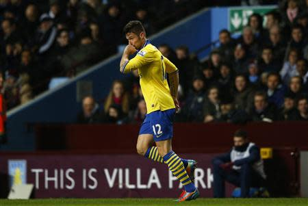 Arsenal's Olivier Giroud celebrates after scoring their second goal against Aston Villa during their English Premier League soccer match at Villa Park in Birmingham