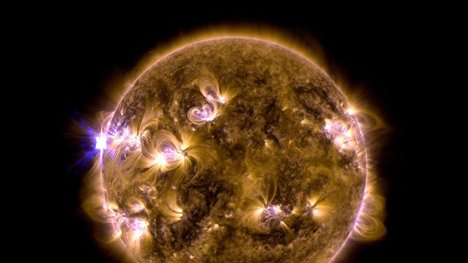 This blend of two images taken by NASA's Solar Dynamics Observatory shows a solar eruption that occurred on May 12, 2013. One image shows light in the 171-angstrom wavelength, the other in 131 angstroms. Scientists say the Mother's Day solar flare was the strongest of the year and occurred on the side of the sun that faced away from Earth. (AP Photo/NASA's Solar Dynamics Observatory)