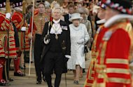 "Britain's Queen Elizabeth II leaves Westminster Hall in London after a Diamond Jubilee Luncheon given for The Queen, Tuesday June 5, 2012 . Crowds cheering ""God save the queen!"" and pealing church bells greeted Queen Elizabeth II on Tuesday as she arrived for a service at St. Paul's Cathedral on the last of four days of celebrations of her 60 years on the throne. (AP Photo/Peter Byrne/Pool)"