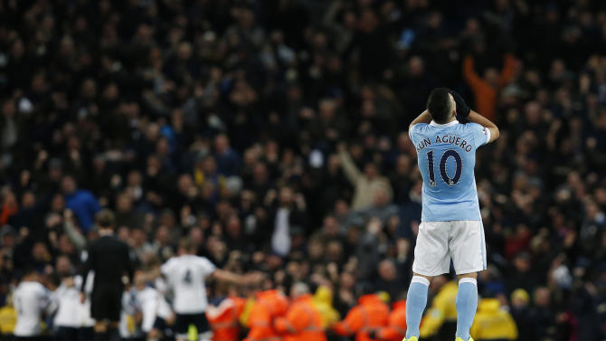 Manchester City's Sergio Aguero looks dejected after Christian Eriksen scored the second goal for Tottenham
