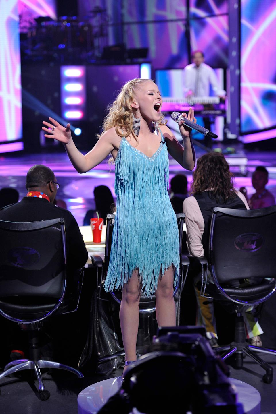 "In this April 4, 2012 photo released by Fox, Hollie Cavanagh performs on the singing competition series ""American Idol,"" in Los Angeles. (AP Photo/Fox, Michael Becker)"