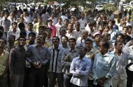 Unidentified relatives of accused wait for verdict outside the district court in Mehsana, about 40 kilometers (25 miles) north of Ahmadabad, India, Wednesday, Nov. 9, 2011. The court convicted 31 Hindus for killing dozens of Muslims by setting a building on fire in Gujurat state during one of India's worst rounds of communal violence nine years ago. (AP Photo/Ajit Solanki)