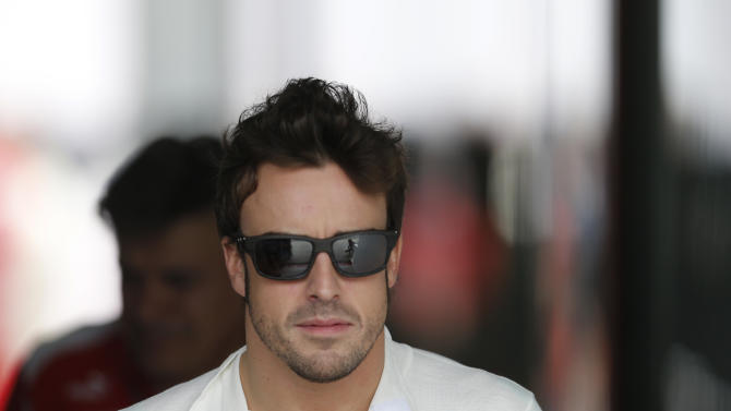 Ferrari driver Fernando Alonso of Spain walks to his pit before a free practice at the Interlagos race track in Sao Paulo, Brazil, Saturday, Nov. 24, 2012. Brazil's Formula One Grand Prix will take place Sunday. (AP Photo/Victor Caivano)