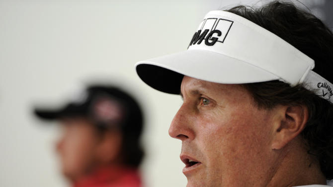 U.S. golfer Phil Mickelson speaks during a press conference in Singapore Wednesday, Nov. 9, 2011. Mickelson said he's ready to show off improved play at this week's Singapore Open golf tournament. At left is Graeme McDowell of Northern Ireland. (AP Photo/Bryan van der Beek)