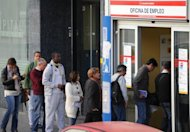 People queue outside a government employment office in the center of Madrid in October 2012. With Spain&#39;s jobless rate above 25 percent, people are looking to countries such as Brazil or Venezuela to find work