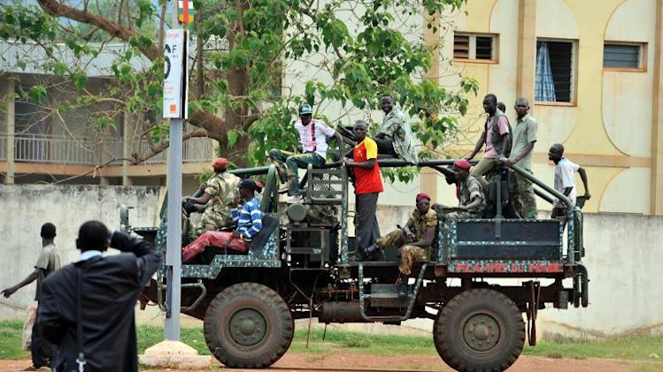 A truck with former Seleka coalition rebels drives by in Bangui on October 7, 2013