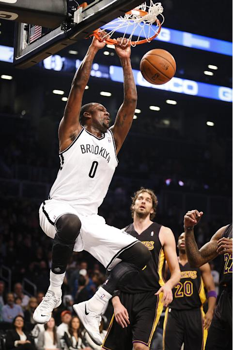 Brooklyn Nets center Andray Blatche (0) dunks as Los Angeles Lakers center Pau Gasol (16), center, looks on in the first quarter of a NBA basketball game at the Barclays Center, Wednesday, Nov. 27, 20
