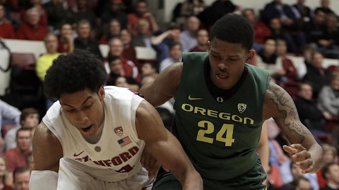 Stanford's Josh Huestis, left, and Oregon's Willie Moore chase a loose ball during the second half of an NCAA college basketball game Wednesday, Jan. 30, 2013, in Stanford, Calif. (AP Photo/Ben Margot)