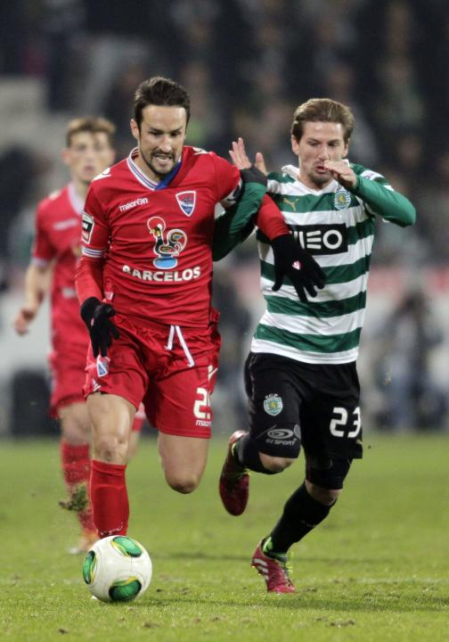 Gil Vicente's Peixoto fights for the ball with Sporting Lisbon's Adrien during their Portuguese Premier League soccer match at the Municipal stadium in Barcelos